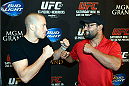 LAS VEGAS, NV - JULY 29:  UFC welterweight champion Georges St-Pierre (L) and Johny Hendricks square off for the media during the UFC World Tour 2013 in the lobby of the MGM Grand Hotel/Casino on July 29, 2013 in Las Vegas, Nevada. Georges St-Pierre will defend the UFC welterweight championship against Johny Hendricks November 16th at UFC 167 in Las Vegas.  (Photo by Jeff Bottari/Zuffa LLC/Zuffa LLC via Getty Images)