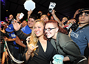 LOS ANGELES, CA - JULY 30:  UFC women's bantamweight champion Ronda Rousey interacts with fans during the UFC World Tour 2013 at Club Nokia at L.A. Live on July 30, 2013 in Los Angeles, California.  (Photo by Jeff Bottari/Zuffa LLC/Zuffa LLC via Getty Images)