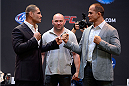 LOS ANGELES, CA - JULY 30:  UFC heavyweight champion Cain Valasquez (L) and upcoming opponent Junior Dos Santos (R) square off in front of UFC president Dana White (C) during the UFC World Tour 2013 press conference at Club Nokia at L.A. Live on July 30, 2013 in Los Angeles, California. Cain Velasquez will defend the UFC heavyweight championship against Junior Dos Santos October 19th at UFC 166 in Houston.  (Photo by Jeff Bottari/Zuffa LLC/Zuffa LLC via Getty Images)