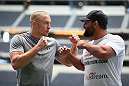 ARLINGTON, TX - AUGUST 02:  Georges St-Pierre and Johny Hendricks face off during a UFC World Tour open workout ahead of a UFC Welterweight Title fight at the AT&T Stadium on August 2, 2013 in Arlington, Texas.  Georges St-Pierre and Johny Hendricks will fight on November 16 in Las Vegas, Nevada.  (Photo by Ronald Martinez/Zuffa LLC/Zuffa LLC via Getty Images)