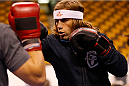 BOSTON, MA - AUGUST 14:  Urijah Faber holds an open training session for fans and media inside TD Garden on August 14, 2013 in Boston, Massachusetts. (Photo by Josh Hedges/Zuffa LLC/Zuffa LLC via Getty Images)