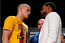 BOSTON, MA - AUGUST 15:  (L-R) Opponents Joe Lauzon and Michael Johnson face off during a UFC press conference at the Wang Theatre on August 15, 2013 in Boston, Massachusetts. (Photo by Josh Hedges/Zuffa LLC/Zuffa LLC via Getty Images)
