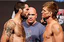 BOSTON, MA - AUGUST 16:  (L-R) Opponents Matt Brown and Mike Pyle face off during the UFC weigh-in inside TD Garden on August 16, 2013 in Boston, Massachusetts. (Photo by Josh Hedges/Zuffa LLC/Zuffa LLC via Getty Images)