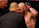 BOSTON, MA - AUGUST 17:  Manny Gamburyan complains about an illegal elbow suffered in his UFC featherweight bout against Cole Miller at TD Garden on August 17, 2013 in Boston, Massachusetts. (Photo by Josh Hedges/Zuffa LLC/Zuffa LLC via Getty Images)