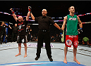 BOSTON, MA - AUGUST 17:  Manny Gamburyan (L) reacts after his decision victory over Cole Miller (R) in their UFC featherweight bout at TD Garden on August 17, 2013 in Boston, Massachusetts. (Photo by Josh Hedges/Zuffa LLC/Zuffa LLC via Getty Images)