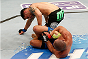 BOSTON, MA - AUGUST 17:  (R-L) Diego Brandao attempts a heel hook submission against Daniel Pineda in their UFC featherweight bout at TD Garden on August 17, 2013 in Boston, Massachusetts. (Photo by Josh Hedges/Zuffa LLC/Zuffa LLC via Getty Images)