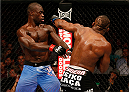 BOSTON, MA - AUGUST 17:  (R-L) John Howard punches Uriah Hall in their UFC middleweight bout at TD Garden on August 17, 2013 in Boston, Massachusetts. (Photo by Josh Hedges/Zuffa LLC/Zuffa LLC via Getty Images)