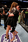 BOSTON, MA - AUGUST 17:  (R-L) Chael Sonnen celebrates with his wife Brittany after his submission victory over Mauricio