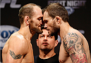 INDIANAPOLIS, IN - AUGUST 27:  (L-R) Opponents Zak Cummings and Benny Alloway face off during the UFC weigh-in event at Bankers Life Fieldhouse on August 27, 2013 in Indianapolis, Indiana. (Photo by Josh Hedges/Zuffa LLC/Zuffa LLC via Getty Images)