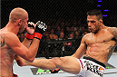 INDIANAPOLIS, IN - AUGUST 28:  (R-L) Rafael dos Anjos kicks Donald