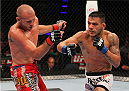 INDIANAPOLIS, IN - AUGUST 28:  (R-L) Rafael dos Anjos punches Donald