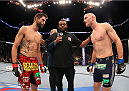 INDIANAPOLIS, IN - AUGUST 28:  (L-R) Opponents Carlos Condit and Martin Kampmann face off before their welterweight fight during the UFC on FOX Sports 1 event at Bankers Life Fieldhouse on August 28, 2013 in Indianapolis, Indiana. (Photo by Ed Mulholland/Zuffa LLC/Zuffa LLC via Getty Images)