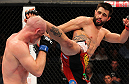 INDIANAPOLIS, IN - AUGUST 28:  (R-L) Carlos Condit kicks Martin Kampmann in their welterweight fight during the UFC on FOX Sports 1 event at Bankers Life Fieldhouse on August 28, 2013 in Indianapolis, Indiana. (Photo by Ed Mulholland/Zuffa LLC/Zuffa LLC via Getty Images)