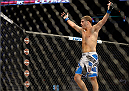 MILWAUKEE, WI - AUGUST 31:  Al Iaquinta celebrates after round one between Ryan Couture (not pictured) in their UFC lightweight bout at BMO Harris Bradley Center on August 31, 2013 in Milwaukee, Wisconsin. (Photo by Jeff Bottari/Zuffa LLC/Zuffa LLC via Getty Images) *** Local Caption *** Al Iaquinta