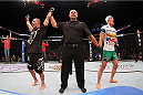 MILWAUKEE, WI - AUGUST 31:  (L-R) Chico Camus celebrates after defeating Kyung Ho Kang in their UFC bantamweight bout at BMO Harris Bradley Center on August 31, 2013 in Milwaukee, Wisconsin. (Photo by Ed Mulholland/Zuffa LLC/Zuffa LLC via Getty Images) *** Local Caption *** Chico Camus; Kyung Ho Kang