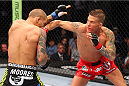 MILWAUKEE, WI - AUGUST 31:  (R-L) Erik Koch punches Dustin Poirier in their UFC featherweight bout at BMO Harris Bradley Center on August 31, 2013 in Milwaukee, Wisconsin. (Photo by Ed Mulholland/Zuffa LLC/Zuffa LLC via Getty Images) *** Local Caption *** Erik Koch; Dustin Poirier