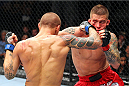 MILWAUKEE, WI - AUGUST 31:  (L-R) Dusitn Poirier punches Erik Koch in their UFC featherweight bout at BMO Harris Bradley Center on August 31, 2013 in Milwaukee, Wisconsin. (Photo by Ed Mulholland/Zuffa LLC/Zuffa LLC via Getty Images) *** Local Caption *** Erik Koch; Dustin Poirier