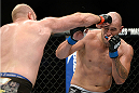 MILWAUKEE, WI - AUGUST 31:  (L-R) Ben Rothwell punches Brandon Vera in their UFC heavyweight bout at BMO Harris Bradley Center on August 31, 2013 in Milwaukee, Wisconsin. (Photo by Jeff Bottari/Zuffa LLC/Zuffa LLC via Getty Images) *** Local Caption *** Ben Rothwell; Brandon Vera