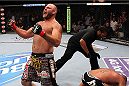 MILWAUKEE, WI - AUGUST 31:  (L-R) Ben Rothwell celebrates after defeating Brandon Vera in their UFC heavyweight bout at BMO Harris Bradley Center on August 31, 2013 in Milwaukee, Wisconsin. (Photo by Ed Mulholland/Zuffa LLC/Zuffa LLC via Getty Images) *** Local Caption *** Ben Rothwell; Brandon Vera; Herb Dean