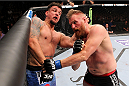 MILWAUKEE, WI - AUGUST 31:  (L-R) Frank Mir punches Josh Barnett in their UFC heavyweight bout at BMO Harris Bradley Center on August 31, 2013 in Milwaukee, Wisconsin. (Photo by Ed Mulholland/Zuffa LLC/Zuffa LLC via Getty Images) *** Local Caption *** Frank Mir; Josh Barnett