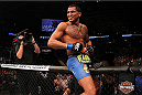 MILWAUKEE, WI - AUGUST 31:  Anthony Pettis celebrates after defeating Benson Henderson in their UFC lightweight championship bout at BMO Harris Bradley Center on August 31, 2013 in Milwaukee, Wisconsin. (Photo by Ed Mulholland/Zuffa LLC/Zuffa LLC via Getty Images) *** Local Caption *** Anthony Pettis