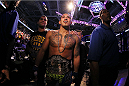 MILWAUKEE, WI - AUGUST 31:  Anthony Pettis celebrates after receiving the lightweight championship belt after defeating Benson Henderson in their UFC lightweight championship bout at BMO Harris Bradley Center on August 31, 2013 in Milwaukee, Wisconsin. (Photo by Ed Mulholland/Zuffa LLC/Zuffa LLC via Getty Images) *** Local Caption *** Anthony Pettis