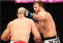 BELO HORIZONTE, BRAZIL - SEPTEMBER 04:  (R-L) Ryan Bader punches Glover Teixeira in their light heavyweight fight during the UFC on FOX Sports 1 event at Mineirinho Arena on September 4, 2013 in Belo Horizonte, Brazil. (Photo by Josh Hedges/Zuffa LLC/Zuffa LLC via Getty Images)