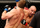 BELO HORIZONTE, BRAZIL - SEPTEMBER 04:  (R-L) Glover Teixeira knocks down Ryan Bader with a punch in their light heavyweight fight during the UFC on FOX Sports 1 event at Mineirinho Arena on September 4, 2013 in Belo Horizonte, Brazil. (Photo by Josh Hedges/Zuffa LLC/Zuffa LLC via Getty Images)