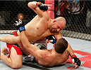 BELO HORIZONTE, BRAZIL - SEPTEMBER 04:  (L-R) Glover Teixeira punches Ryan Bader in their light heavyweight fight during the UFC on FOX Sports 1 event at Mineirinho Arena on September 4, 2013 in Belo Horizonte, Brazil. (Photo by Josh Hedges/Zuffa LLC/Zuffa LLC via Getty Images)