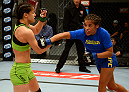 LAS VEGAS, NV - JUNE 6:  (R-L) Julianna Pena punches Shayna Baszler in their preliminary fight during filming of season eighteen of The Ultimate Fighter on June 6, 2013 in Las Vegas, Nevada. (Photo by Al Powers/Zuffa LLC/Zuffa LLC via Getty Images)