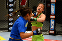 LAS VEGAS, NV - JUNE 6:  (L-R) Julianna Pena punches Shayna Baszler in their preliminary fight during filming of season eighteen of The Ultimate Fighter on June 6, 2013 in Las Vegas, Nevada. (Photo by Al Powers/Zuffa LLC/Zuffa LLC via Getty Images)