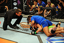 LAS VEGAS, NV - JUNE 6:  Julianna Pena (blue shorts) submits Shayna Baszler (green shorts) in their preliminary fight during filming of season eighteen of The Ultimate Fighter on June 6, 2013 in Las Vegas, Nevada. (Photo by Al Powers/Zuffa LLC/Zuffa LLC via Getty Images)