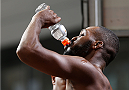 "TORONTO, CANADA - SEPTEMBER 20:  Jon ""Bones"" Jones re-hydrates after making weight during the UFC 165 weigh-in event at Maple Leaf Square outside the Air Canada Centre on September 20, 2013 in Toronto, Ontario, Canada. (Photo by Josh Hedges/Zuffa LLC/Zuffa LLC via Getty Images)"