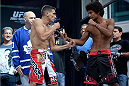 TORONTO, CANADA - SEPTEMBER 20:  (L-R) Roland Delorme and Alex Caceres face off during the UFC 165 weigh-in at the Maple Leaf Square on September 20, 2013 in Toronto, Ontario, Canada. (Photo by Jeff Bottari/Zuffa LLC/Zuffa LLC via Getty Images)