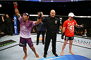 TORONTO, CANADA - SEPTEMBER 21:  (L-R) Michel Prazeres celebrates after defeating Jesse Ronson in their UFC lightweight bout at the Air Canada Center on September 21, 2013 in Toronto, Ontario, Canada. (Photo by Al Bello/Zuffa LLC/Zuffa LLC via Getty Images) *** Local Caption *** Michel Prazeres; Jesse Ronson