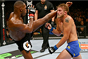 TORONTO, CANADA - SEPTEMBER 21:  (L-R) Jon 'Bones' Jones kicks Alexander Gustafsson in their UFC light heavyweight championship bout at the Air Canada Center on September 21, 2013 in Toronto, Ontario, Canada. (Photo by Al Bello/Zuffa LLC/Zuffa LLC via Getty Images) *** Local Caption *** Jon Jones; Alexander Gustafsson