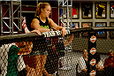 LAS VEGAS, NV - JUNE 12:  Coach Ronda Rousey looks over the Octagon prior to the bout between Jessica Rakoczy and Roxanne Modafferi (not pictured) in their preliminary fight during filming of season eighteen of The Ultimate Fighter on June 12, 2013 in Las Vegas, Nevada. (Photo by Al Powers/Zuffa LLC/Zuffa LLC via Getty Images) *** Local Caption *** Ronda Rousey