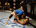 LAS VEGAS, NV - JUNE 12:  (L-R) Roxanne Modafferi takes down Jessica Rakoczy in their preliminary fight during filming of season eighteen of The Ultimate Fighter on June 12, 2013 in Las Vegas, Nevada. (Photo by Al Powers/Zuffa LLC/Zuffa LLC via Getty Images) *** Local Caption *** Jessica Rakoczy; Roxanne Modafferi