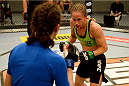 LAS VEGAS, NV - JUNE 12:  (R-L) Jessica Rakoczy attacks Roxanne Modafferi in their preliminary fight during filming of season eighteen of The Ultimate Fighter on June 12, 2013 in Las Vegas, Nevada. (Photo by Al Powers/Zuffa LLC/Zuffa LLC via Getty Images) *** Local Caption *** Jessica Rakoczy; Roxanne Modafferi