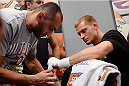 LAS VEGAS, NV - JUNE 14:  David Grant (R) gets his hands wrapped by trainer Team Rousey trainer Edmond Tarverdyan (L) before his preliminary fight against Louis Fisette (not pictured) during filming of season eighteen of The Ultimate Fighter on June 14, 2013 in Las Vegas, Nevada. (Photo by Al Powers/Zuffa LLC/Zuffa LLC via Getty Images) *** Local Caption ***David Grant; Edmond Tarverdyan
