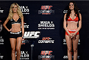 BARUERI, BRAZIL - OCTOBER 8:  (L-R) UFC Octagon Girls Jhenny Andrade and Camila Rodrigues de Oliveira stands on stage during the UFC Fight Night: Maia v Shields weigh-in at the Ginasio Jose Correa on October 8, 2013 in Barueri, Sao Paulo, Brazil. (Photo by Jeff Bottari/Zuffa LLC/Zuffa LLC via Getty Images)