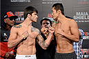 BARUERI, BRAZIL - OCTOBER 8:  (L-R) Erick Silva and Dong Hyun Kim face off during the UFC Fight Night: Maia v Shields weigh-in at the Ginasio Jose Correa on October 8, 2013 in Barueri, Sao Paulo, Brazil. (Photo by Jeff Bottari/Zuffa LLC/Zuffa LLC via Getty Images)
