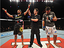 BARUERI, BRAZIL - OCTOBER 9:  (L-R) Yan Cabral celebrates after defeating David Mitchell in their welterweight bout during the UFC Fight Night event at the Ginasio Jose Correa on October 9, 2013 in Barueri, Sao Paulo, Brazil. (Photo by Jeff Bottari/Zuffa LLC/Zuffa LLC via Getty Images)