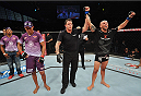 BARUERI, BRAZIL - OCTOBER 9:  (R-L) Igor Araujo celebrates after defeating Ildemar Alcantara in their welterweight bout during the UFC Fight Night event at the Ginasio Jose Correa on October 9, 2013 in Barueri, Sao Paulo, Brazil. (Photo by Jeff Bottari/Zuffa LLC/Zuffa LLC via Getty Images)