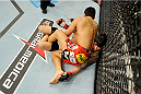 BARUERI, BRAZIL - OCTOBER 9:  Erick Silva lies pinned underneath Dong Hyun Kim (red shorts) in their welterweight bout during the UFC Fight Night event at the Ginasio Jose Correa on October 9, 2013 in Barueri, Sao Paulo, Brazil. (Photo by Jeff Bottari/Zuffa LLC/Zuffa LLC via Getty Images)
