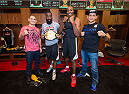 HOUSTON, TX - OCTOBER 16:  (L-R) UFC Heavyweight Champion Cain Velasquez, NBA Houston Rockets players James Harden, Dwight Howard and UFC fighter Junior Dos Santos pose in the Houston Rockets locker room during the UFC 166 Ultimate Media Day at the Toyota Center on October 16, 2013 in Houston, Texas. (Photo by Jeff Bottari/Zuffa LLC/Zuffa LLC via Getty Images) *** Local Caption *** Cain Velasquez; James Harden; Dwight Howard; Junior Dos Santos