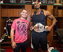 HOUSTON, TX - OCTOBER 16:  (L-R) UFC Heavyweight Champion Cain Velasquez and NBA Houston Rockets player Dwight Howard pose in the Houston Rockets locker room during the UFC 166 Ultimate Media Day at the Toyota Center on October 16, 2013 in Houston, Texas. (Photo by Jeff Bottari/Zuffa LLC/Zuffa LLC via Getty Images) *** Local Caption *** Cain Velasquez; Dwight Howard