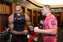 HOUSTON, TX - OCTOBER 16:  (L-R) Houston Rockets player Dwight Howard laughs as he faces off against UFC Heavyweight Champion Cain Velasquez in the Houston Rockets locker room during the UFC 166 Ultimate Media Day at the Toyota Center on October 16, 2013 in Houston, Texas. (Photo by Jeff Bottari/Zuffa LLC/Zuffa LLC via Getty Images) *** Local Caption *** Cain Velasquez; Dwight Howard