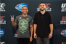 HOUSTON, TX - OCTOBER 16:  John Dodson (L) and Darrell Montague (R) pose for the media during the UFC 166 Ultimate Media Day at the Toyota Center on October 16, 2013 in Houston, Texas. (Photo by Jeff Bottari/Zuffa LLC/Zuffa LLC via Getty Images) *** Local Caption *** John Dodson; Darrell Montague