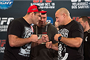 HOUSTON, TX - OCTOBER 16:  Gabriel Gonzaga (L) and Shawn Jordan (R) face off in front of UFC President Dana White (C) for the media during the UFC 166 Ultimate Media Day at the Toyota Center on October 16, 2013 in Houston, Texas. (Photo by Jeff Bottari/Zuffa LLC/Zuffa LLC via Getty Images) *** Local Caption *** Gabriel Gonzaga; Shawn Jordan; Dana White